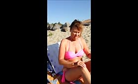 Filming his topless beach wife