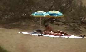 Swingers teasing on nudist beach