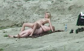 Blonde on the beach riding cock