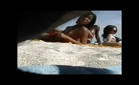 Topless hot ebony beach babes