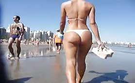 String bikini ass walking on the beach
