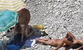 Two couples fucking on a beach